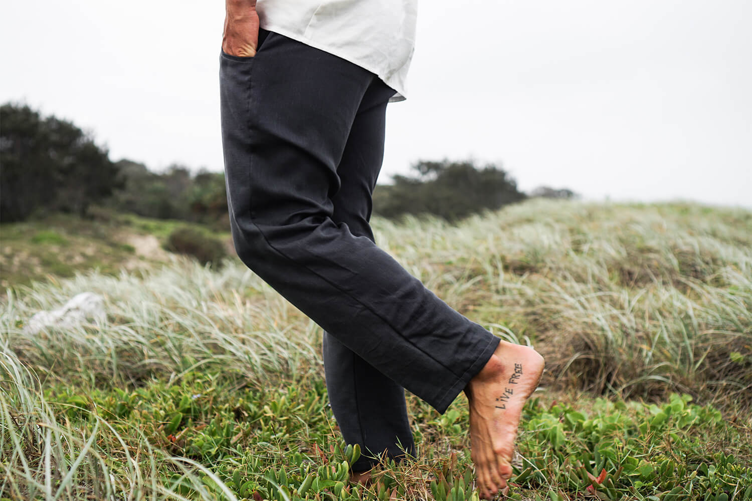 Tasi Travels' Men's Charcoal Roamer Pants are handmade from a sustainable Tencel & hemp blend