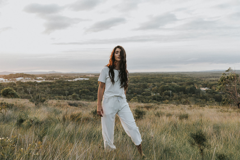 Tasi Travels' Women's White Roamer Pants are handmade from a sustainable Tencel & hemp blend