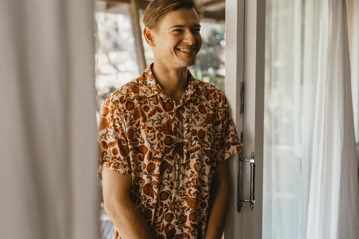Tasi Travels' Men's Native Paisley Short-Sleeve Voyager Shirt is handmade from sustainable modal