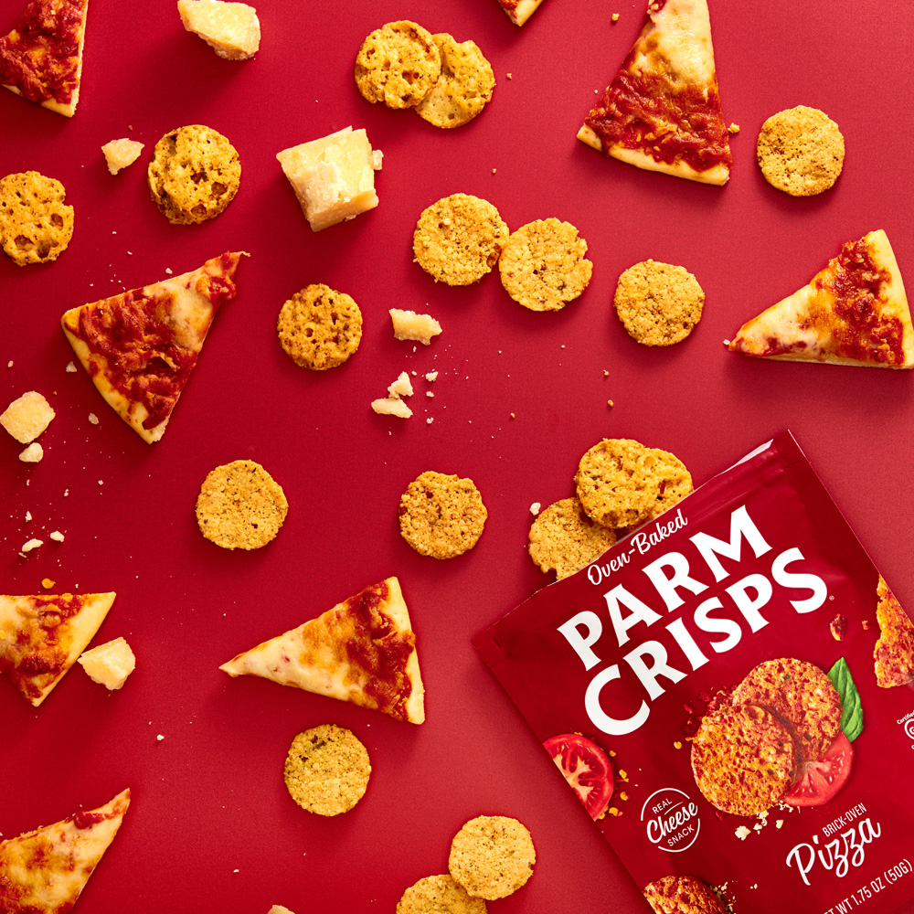 overhead shot of Pizza ParmCrisps chips with small slices of pizza